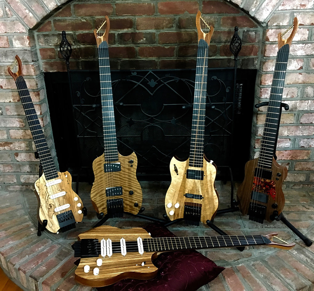 CharlestonGuitars_by_fireplace.jpg