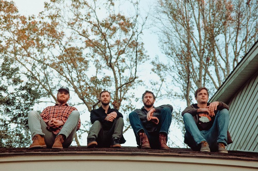 Group sit rooftop (1 of 1).jpg