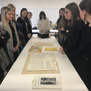 Katy Rogers of Dedalus Foundation shows archival documents to graduate students, photo credit Kathy Battista