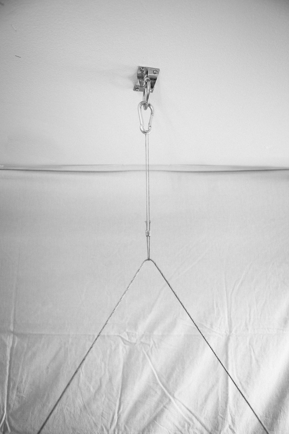 Indoor hanging system w/ carabiner, aircraft wire, and ceiling anchor