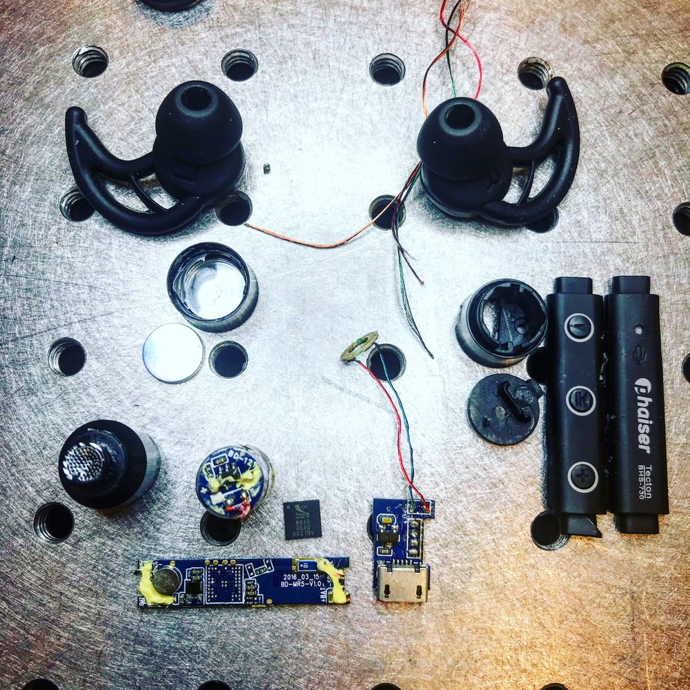 Full layout of parts disassebled from the Phaiser Bluetooth Headphones.