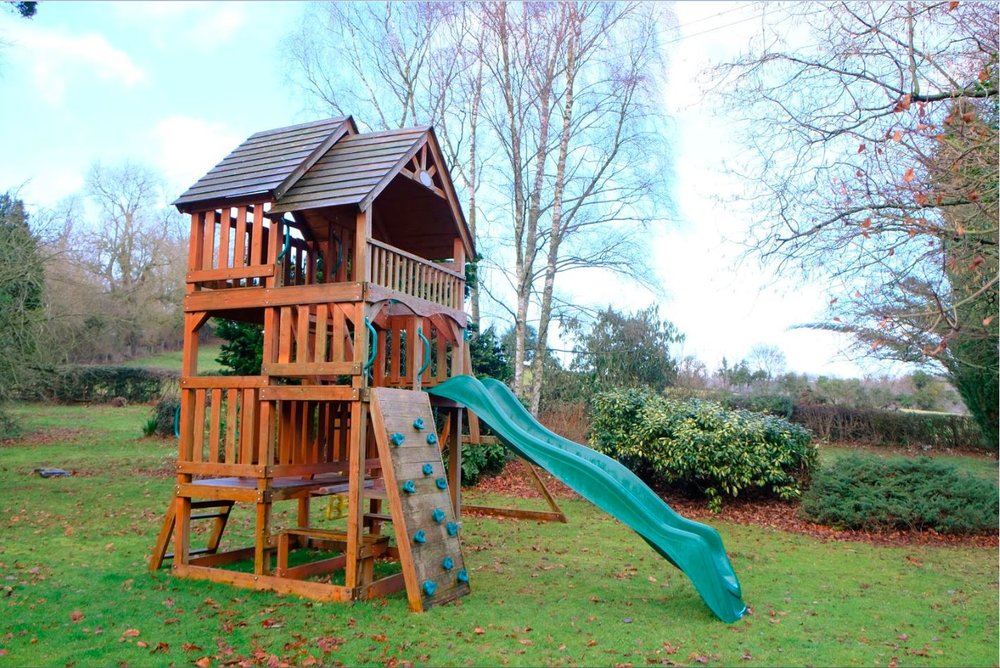 Swings, a slide and a den to hide in