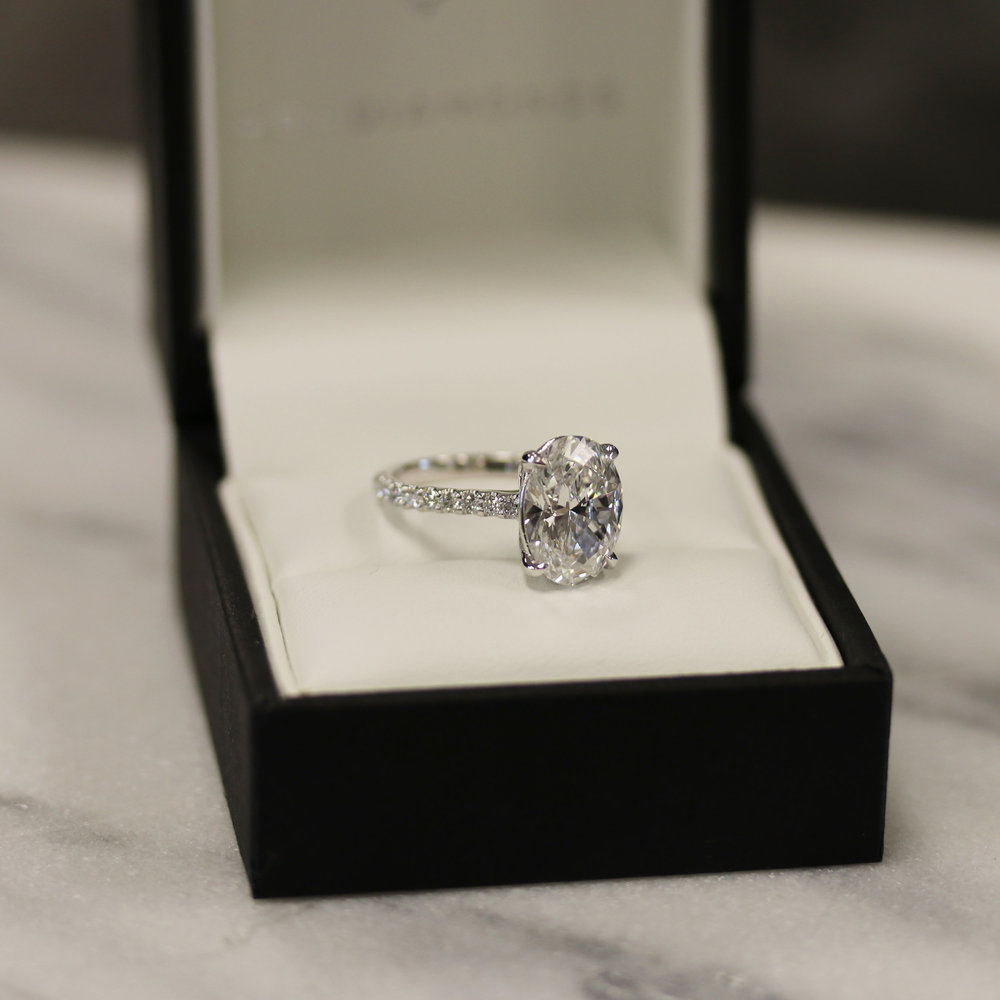 3 carat lab grown oval diamond engagement ring with pave set band