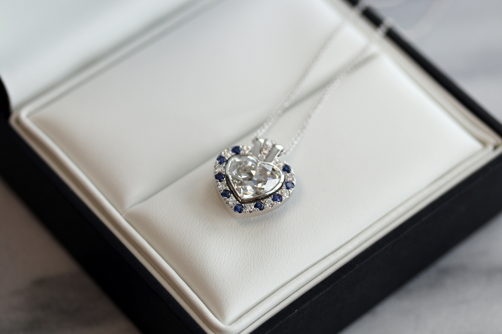 heart cut lab grown diamond 5 carat pendant necklace with fancy blue diamond halo