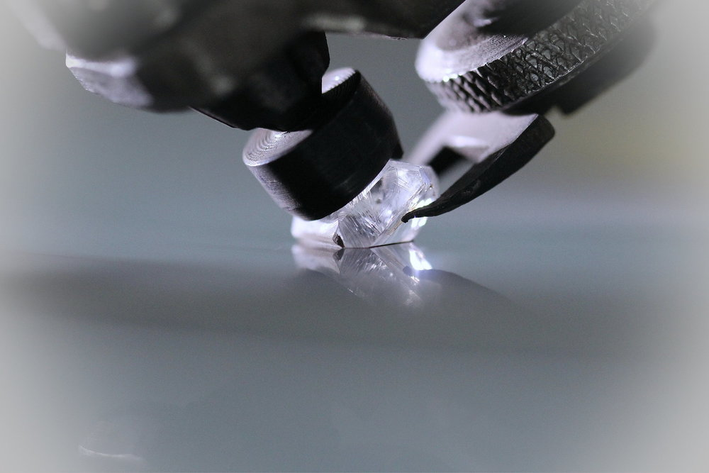 Rough Diamond being cut and polished.