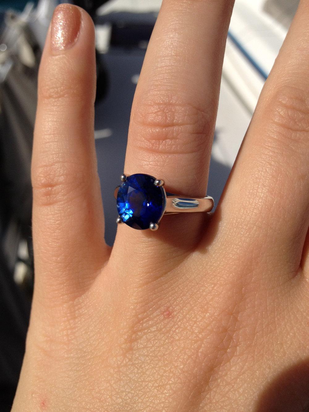 Dark blue sapphire engagement ring