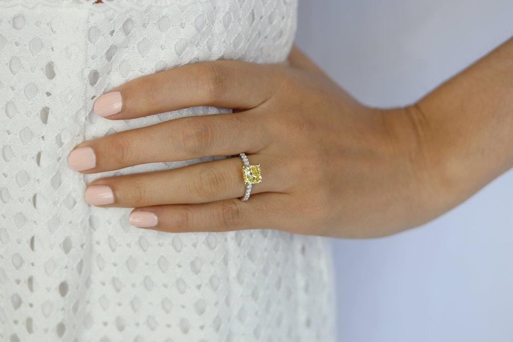 nine carat fancy blue and fancy yellow diamond ring