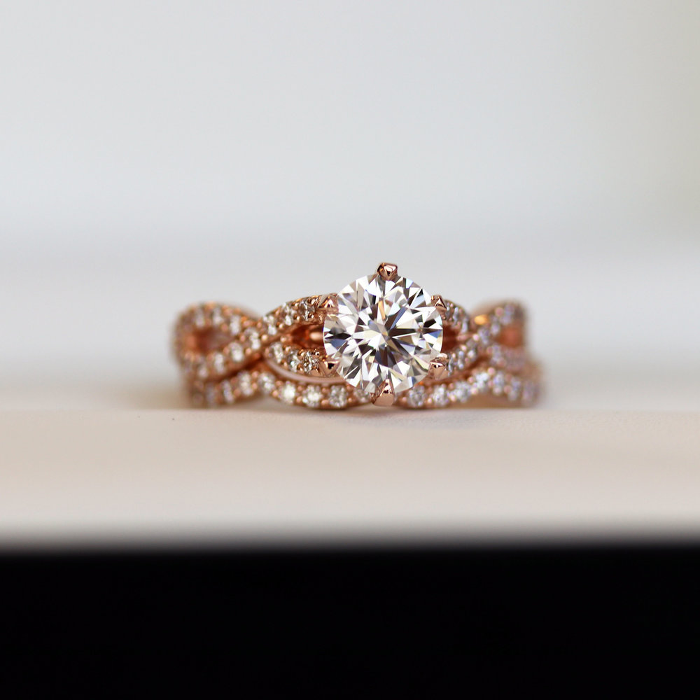 rose gold lab diamond engagement ring with round brilliant center stone and weaving diamond band