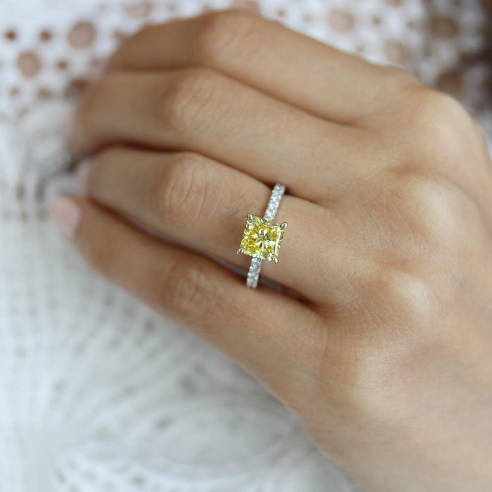 fancy yellow lab diamond engagement ring with diamonds down the band