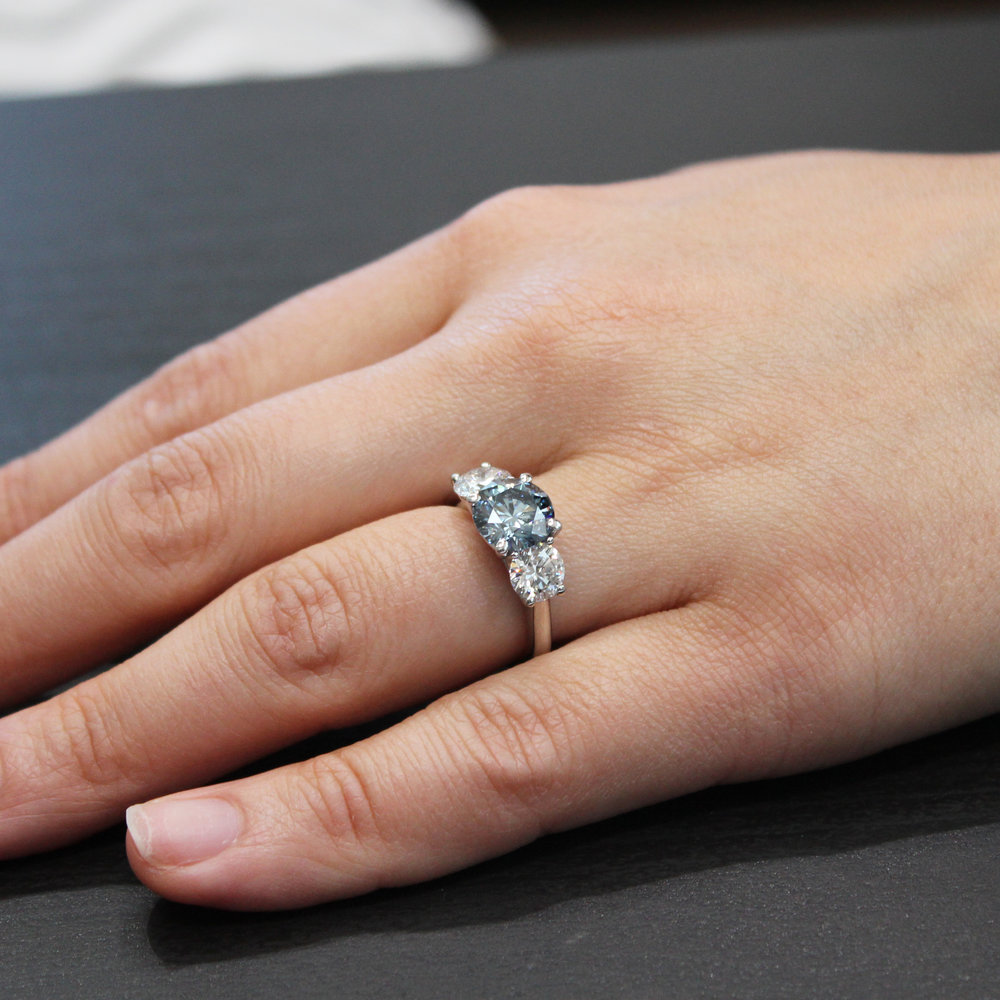 Three Stone Ring with blue diamond center