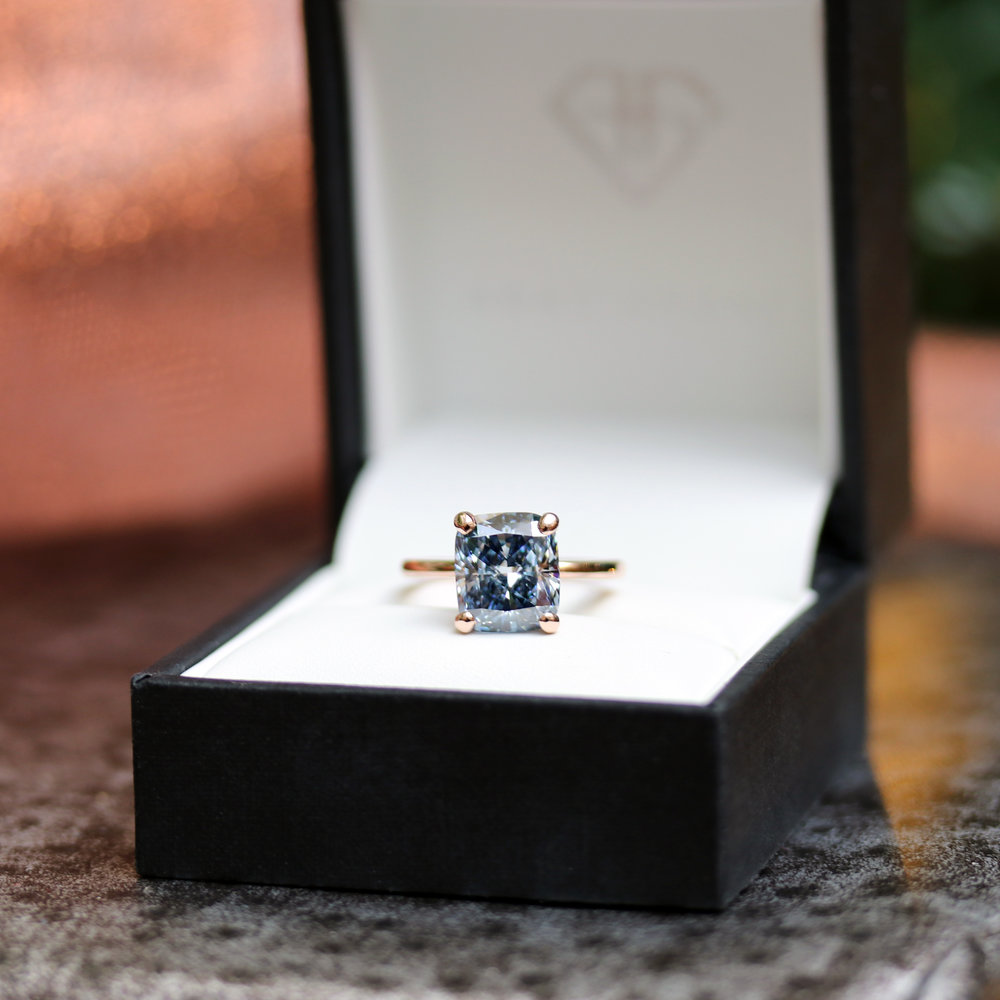 Four prong fancy blue cushion cut lab diamond engagement ring in 18k rose gold