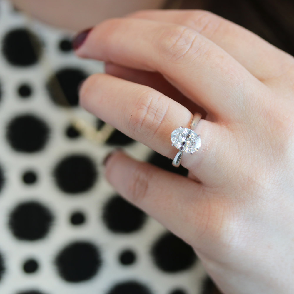 Lab Grown oval diamond engagement ring with tapered band white gold