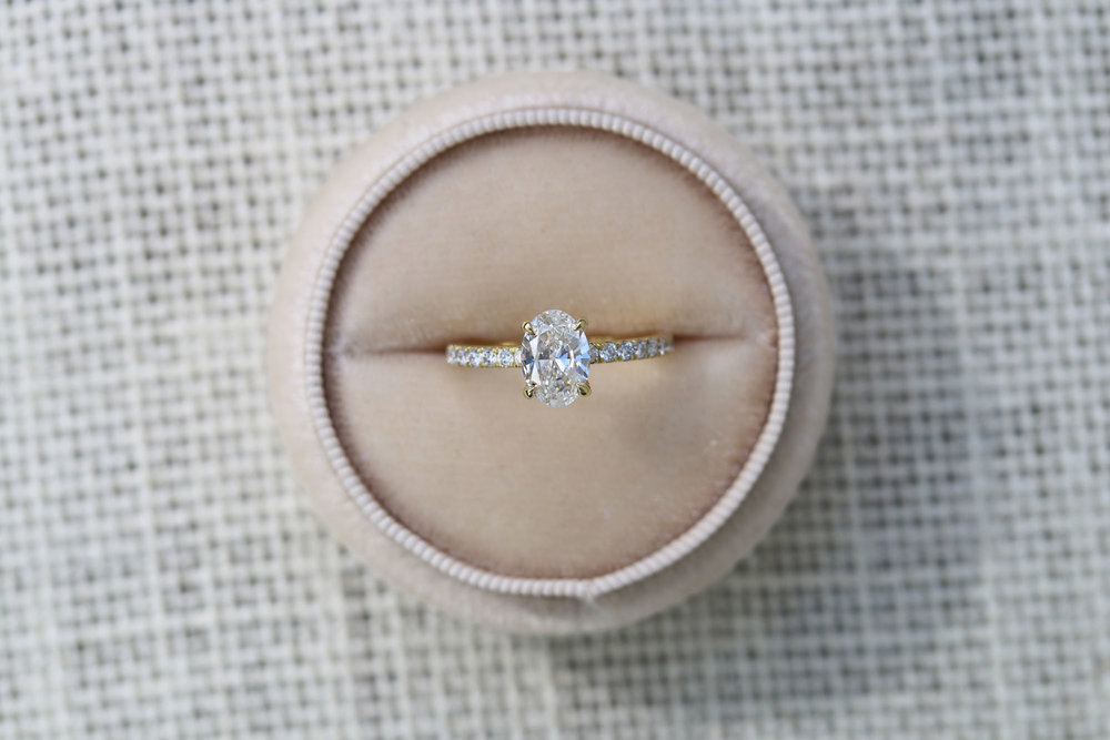Lab grown oval diamond solitaire engagement ring in yellow gold