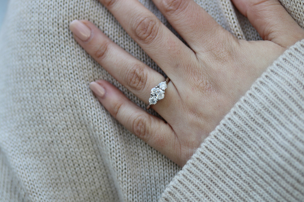 three stone engagement ring platinum lab grown diamonds on hand.jpg