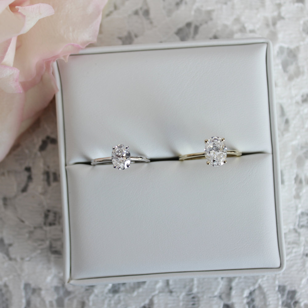 Four Prong Oval Solitaires White and Yellow Gold Engagement Rings