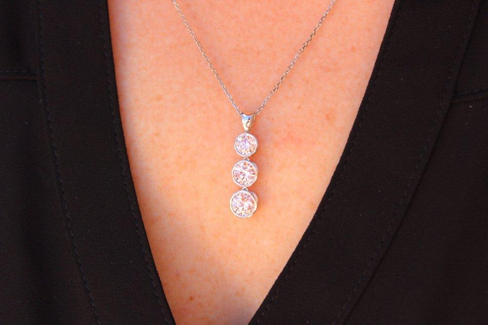 Triple bezel cosmopolitan necklace with fancy pink lab grown diamonds