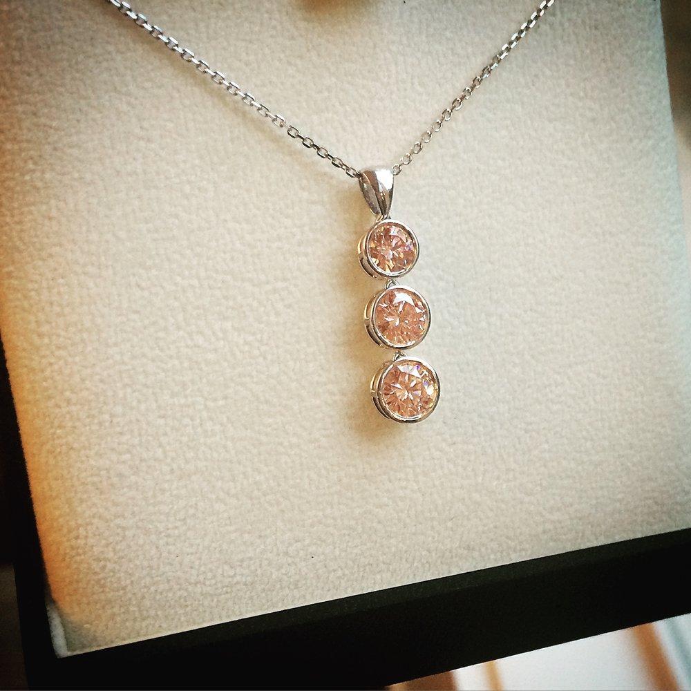 Fancy pink lab grown diamond three stone pendant necklace
