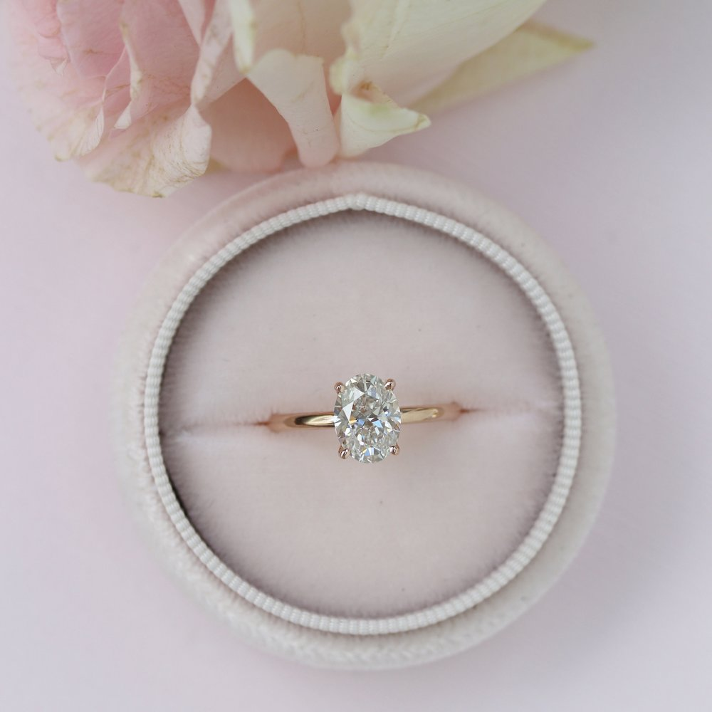Four prong oval solitaire engagement ring in rose gold