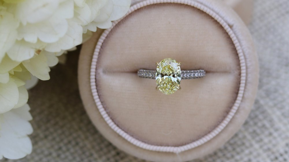 fancy yellow oval lab created diamond engagement ring with pave set diamond band Ada Diamonds