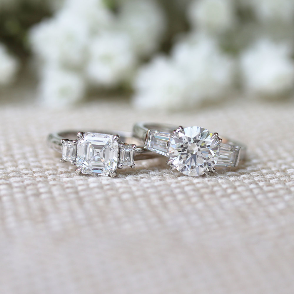 Three stone lab diamond engagement ring with round center stone and baguette side stones