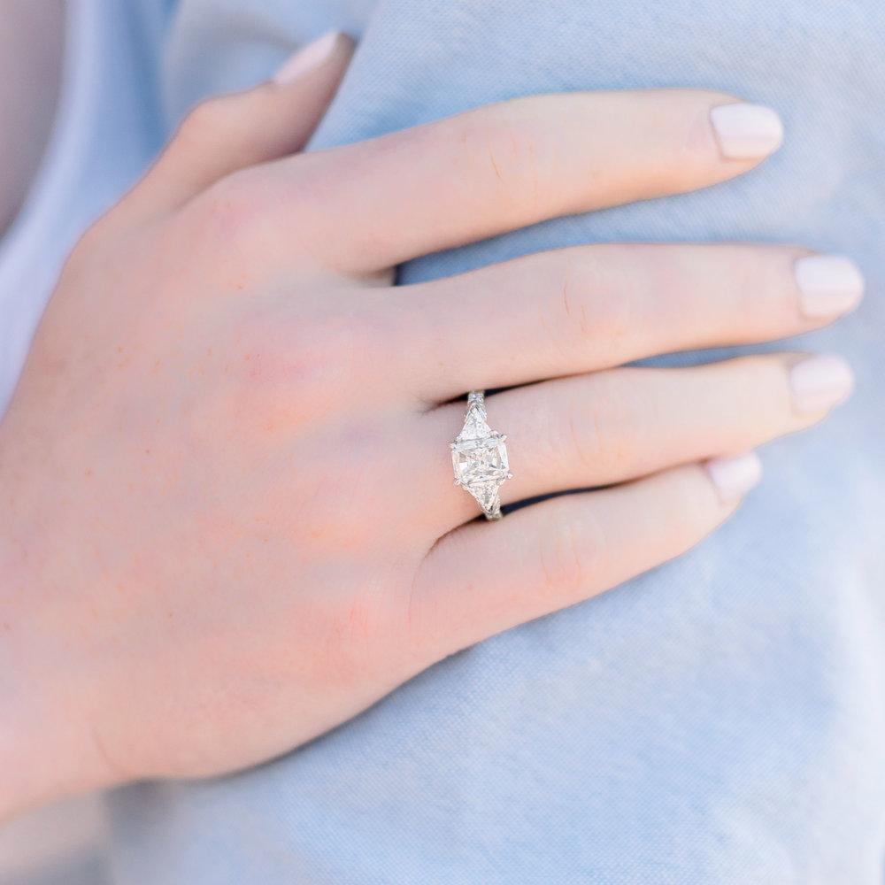 radiant-trillion-three-stone-engagement-ring-white-gold-pave-band-on-model.jpg