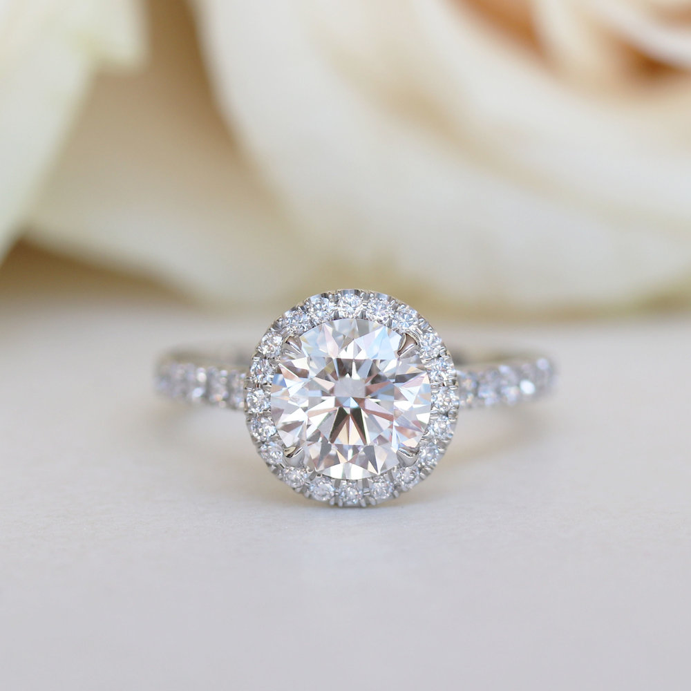 lab grown diamond halo engagement ring with diamonds down the band in platinum