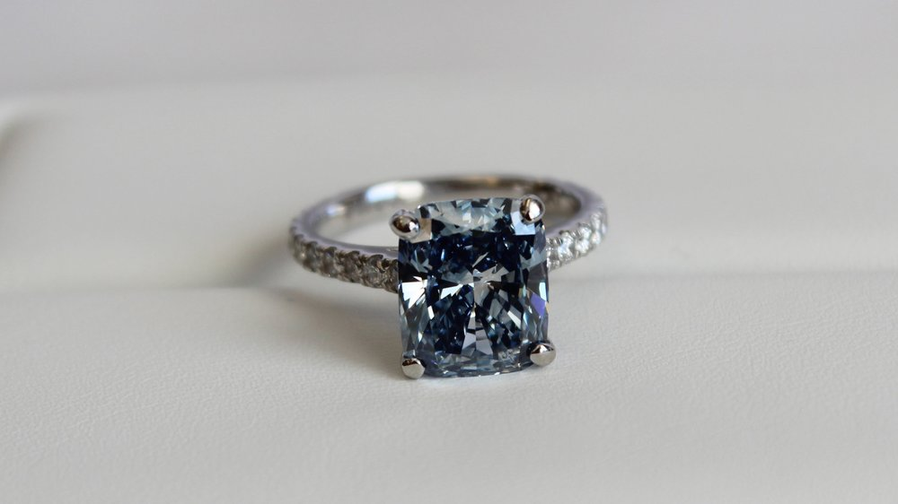 blue cushion cut lab grown diamond pavé engagement ring