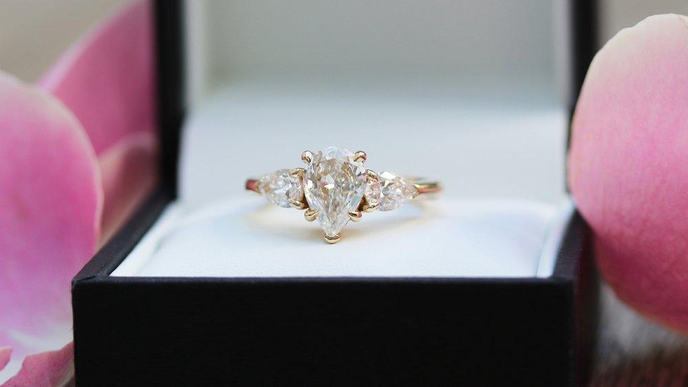 three stone pear lab diamond engagement ring