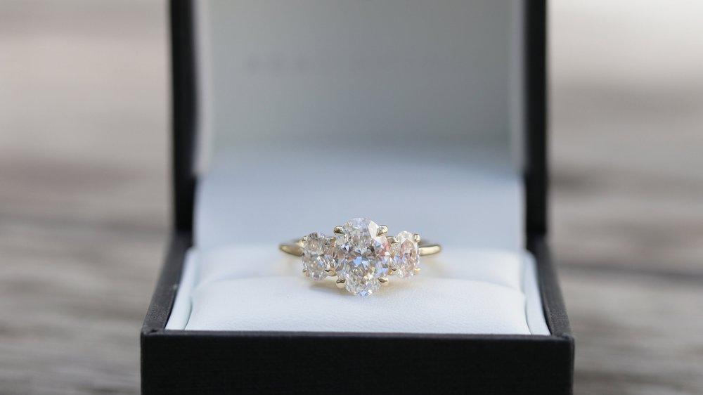 oval three stone lab diamond engagement ring