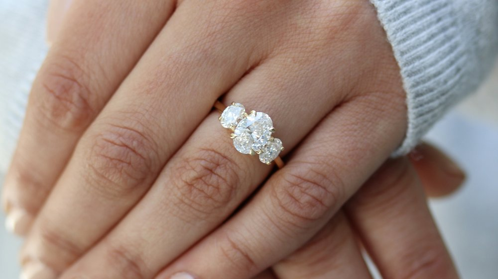 three stone oval lab grown diamond engagement ring