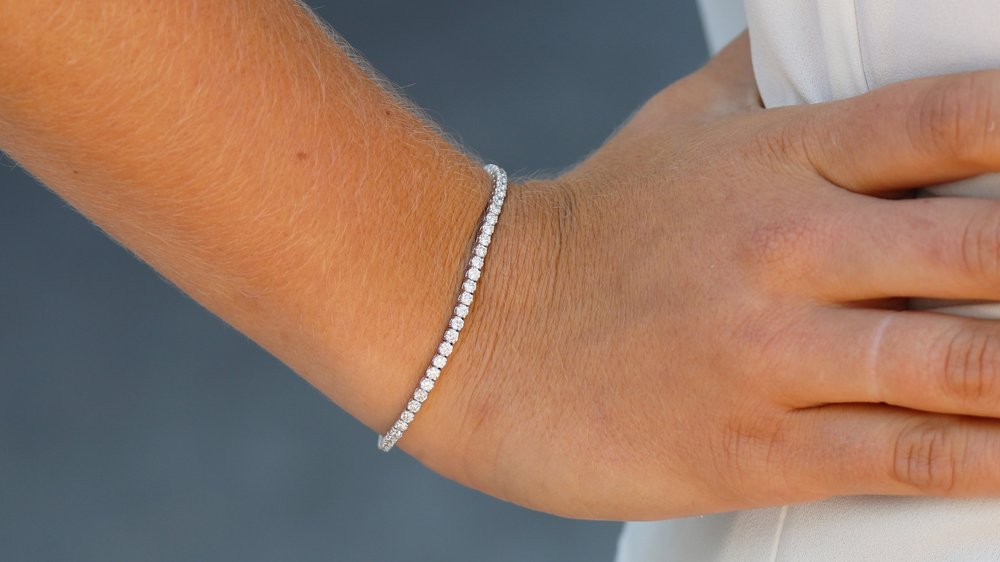 lab diamond three layer tennis bracelet and lab diamond right band ring spinning stacked band by Ada Diamonds.