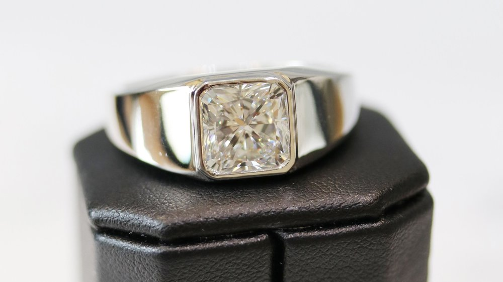 Men's Bezel Set Ring in Platinum Featuring a 4.37ct Radiant Cut center stone.