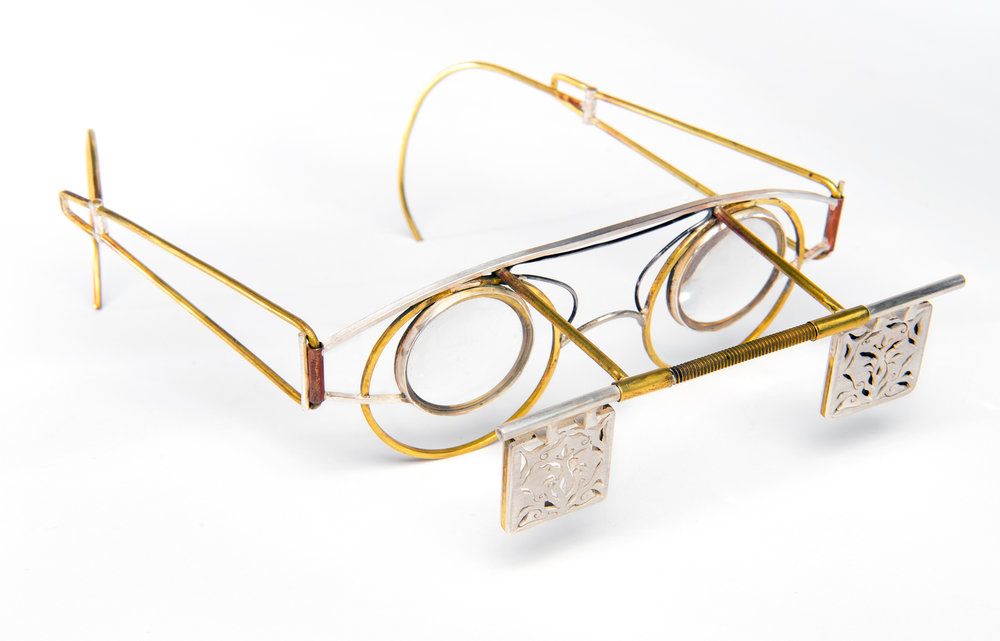 to magnify  | hand pierced sterling silver, forged brass, bezel set acetate lens, photographs