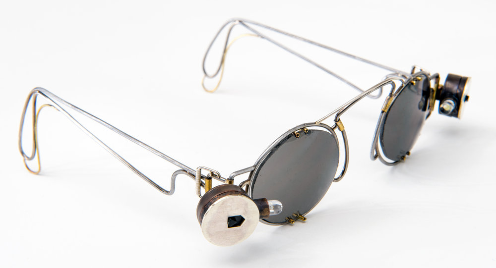 to illuminate |  sterling silver, stainless steel frame and ear wire, prong set acetate lens, led lights