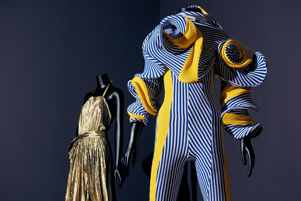 "Above  From the MoMA exhibition ""Items: Is Fashion Modern?"" Left, jumpsuit by Stephen Burrows, circa 1974. Right, jumpsuit by Richard Malone, 2017,  Photo:    Vincent Tullo for The New York Times"