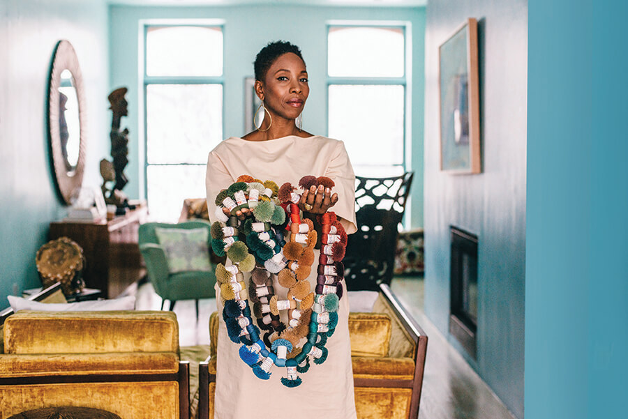 Above  Malene at home with a sample of rug color swatches,  Photo: Julia Hembree for    BK Magazine