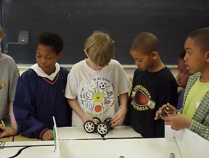 This picture shows how robotics engages kinesthetic learners. Notice how all the students are standing up, and the second and fourth students quite literally have their hands on their projects.