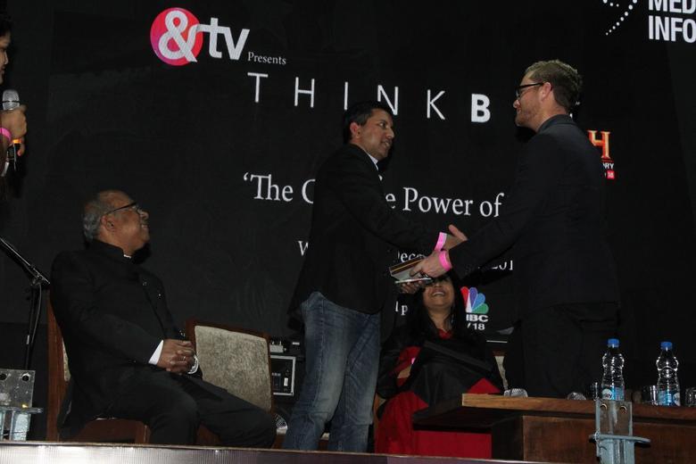 winner_detail_slideshow_IMG_7733_mike_on_stage_shaking_hands.jpg