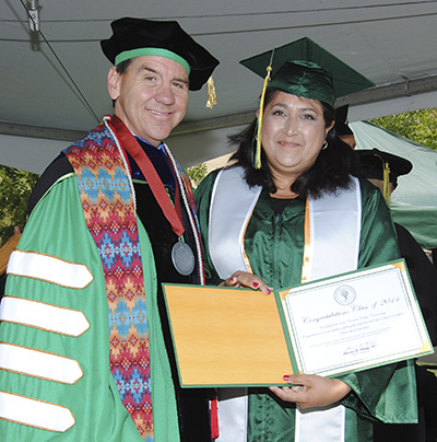 Cañada President, Larry Buckley with SASS recipient Laura Irene Carranza Rodriguez at the Cañada graduation ceremony.