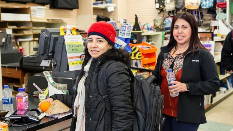 Johanna (left) uses her food voucher to get lunch at the Cañada bookstore.  Photo courtesy of Mary Bender.