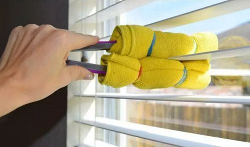 Wrap a microfiber cloth around kitchen tongs to clean window blinds. -