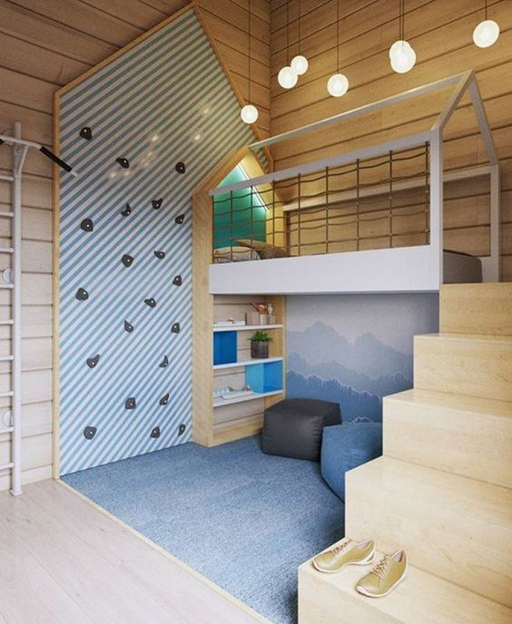 This room was designed by Russian Interior designer  Ekaterina Domracheva . It makes me question what kid wouldn't want a climbing wall in their bed room?
