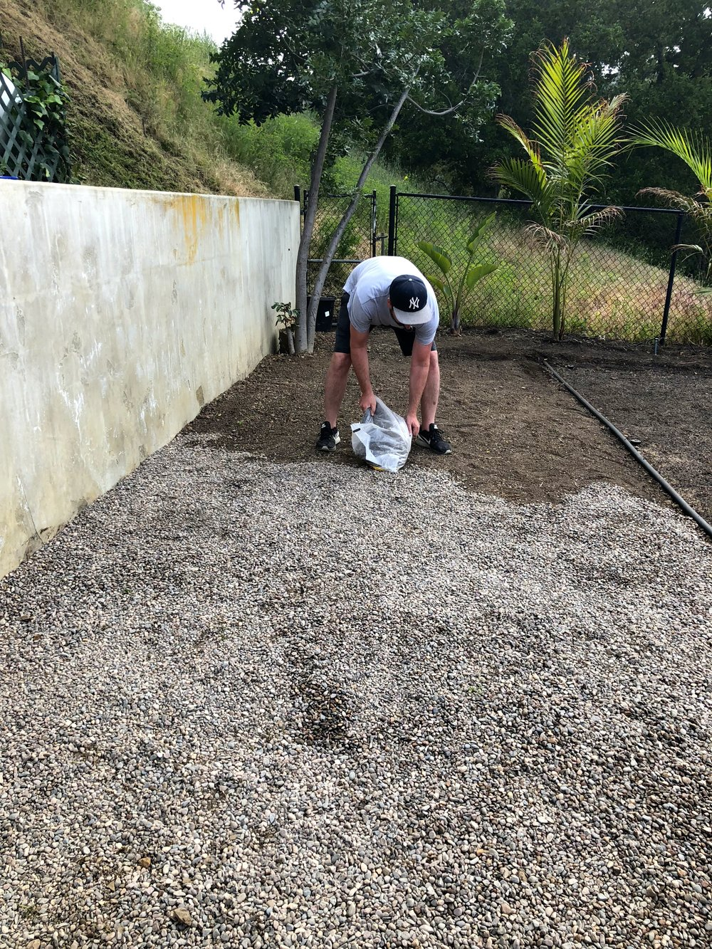 Next we purchased many bags of  pea gravel  from Home Depot, and spread them out like above.