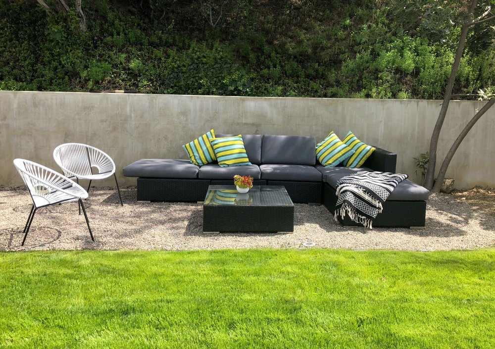 We have had this set of outdoor patio furniture for about 6 years now. Last summer, I reupholstered the cushions, and now the set looks like new again.