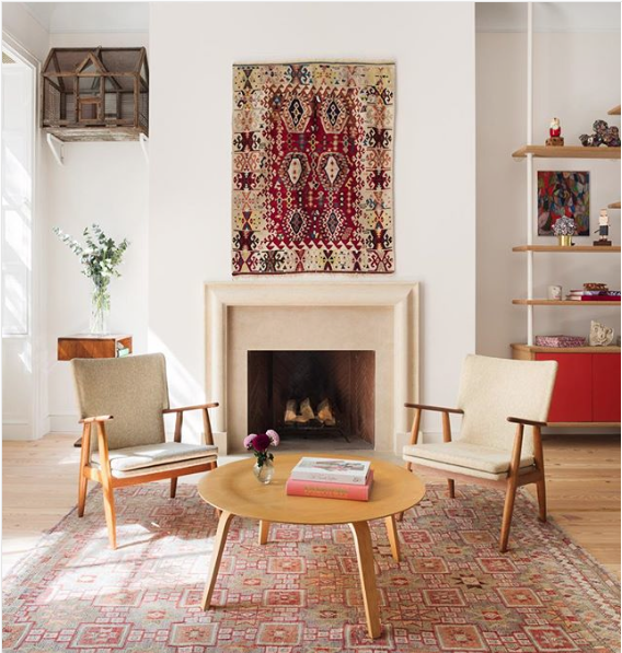 I love how an artsy couple hung this rug above their fireplace.