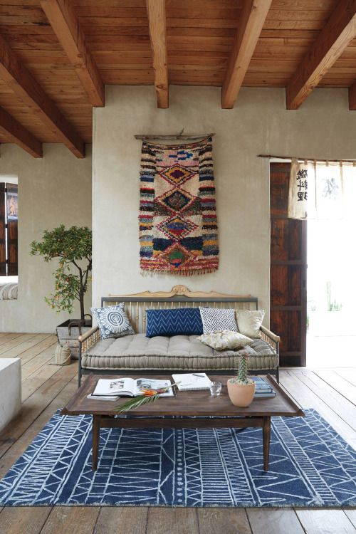 The driftwood hanger is a nice touch to this beautiful rug.