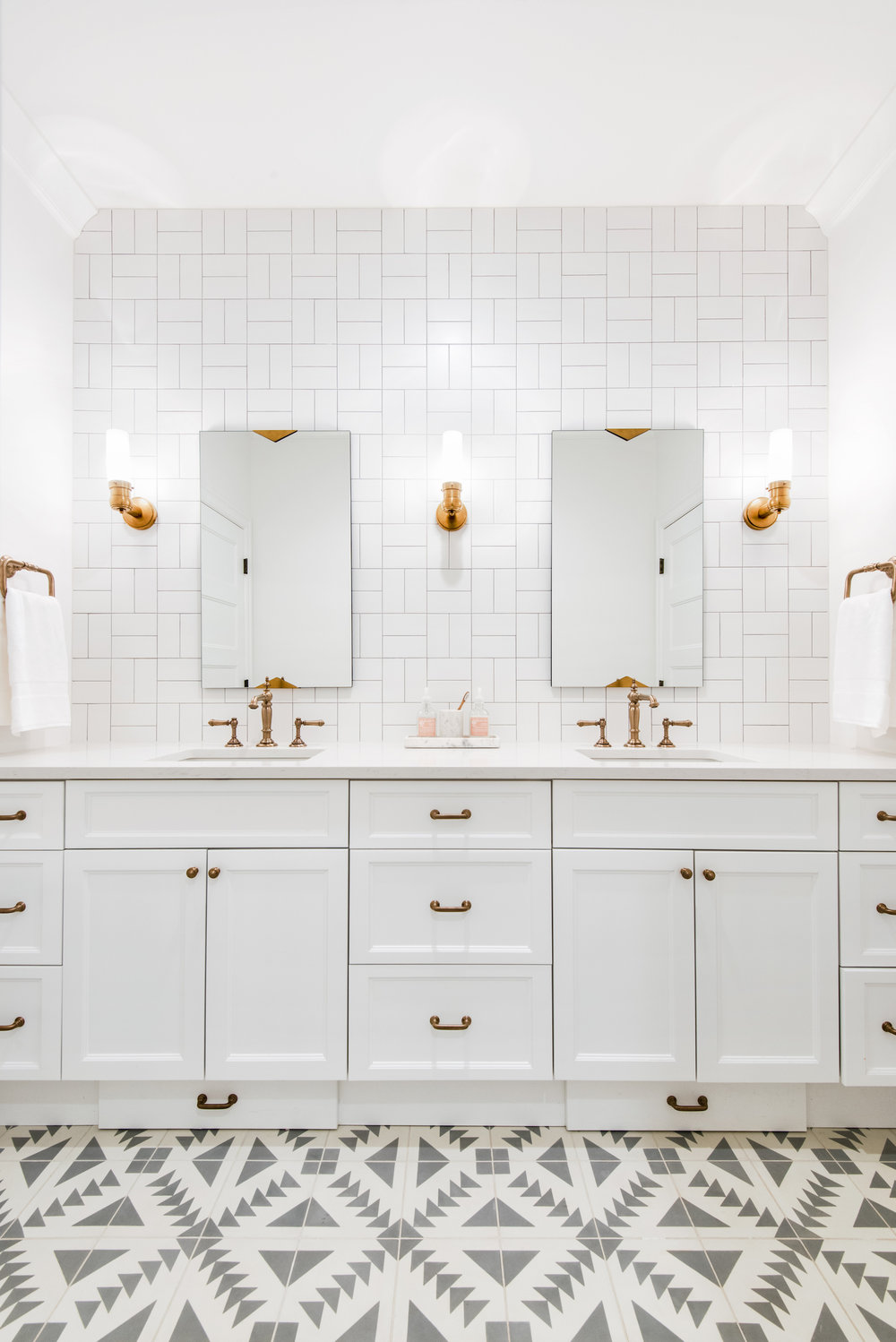 Caitlin Wilson  used the cross hatch method in her bathroom, paired with aztec tile for a fresh look!
