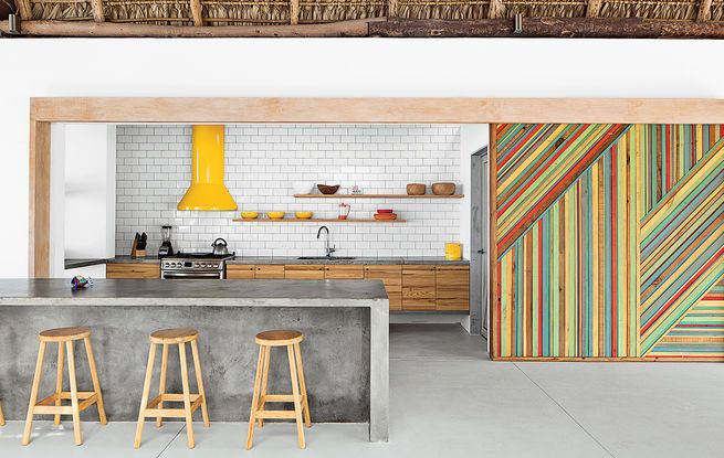 This simple offset subway tile pattern, pairs perfectly with pops of color in this  bright home in El Salvador.