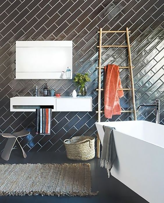 I love this pattern because it is not seen as often. The black tile shown here makes this bathroom so fierce! Image via  home designing .