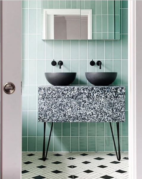 Vertical stack bond can make a big impact, especially if it is done with colored subway tile. Image via  Pinterest .